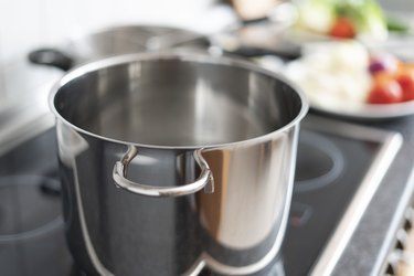 Blanching vegetables in large cooking pot preparation