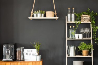 Hanging shelf and bookcase with decor