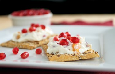 Pomegranate apricot cream cheese spread on cracker