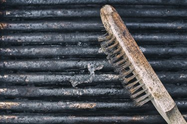Close-Up Of Dirty used Barbecue Grill and scrubber