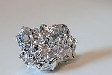 Crumpled heavy duty silver aluminum foil sheet