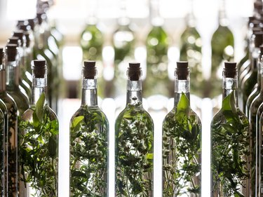Bottle filling and preparation of traditional liqueur based on anise and moonshine with aromatic herbs, (herbero).