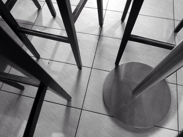 Cropped Image Of Stools And Table At Bar