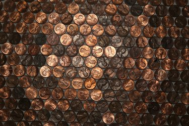 Close-up Of Coins On Table