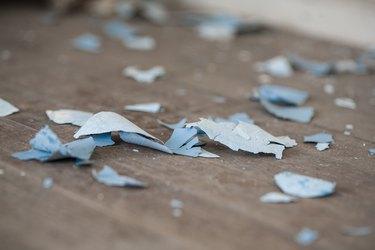 Paint chips on old hardwood floor