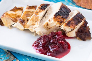 Sliced turkey breast with cranberry sauce