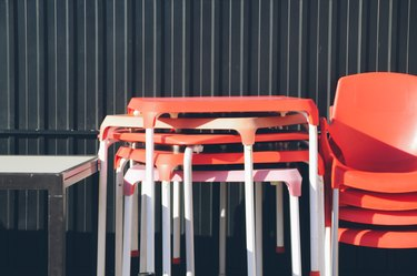 Stacked plastic tables and chairs