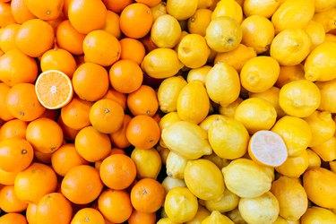 Fresh oranges and lemons on a market stall