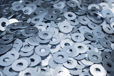 Cut metal washers in engineering factory, close up