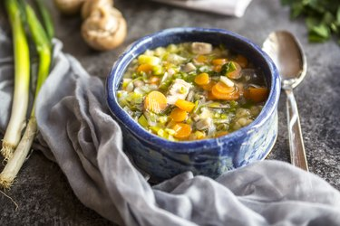 Turkey soup with leek, carrots, noodles, spring onions, champignons and parsley