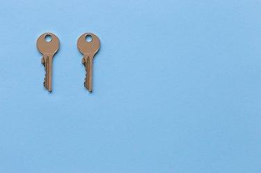 Close-Up Of Keys Over Blue Background