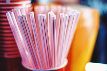 Close-Up Of Drinking Straws In Container