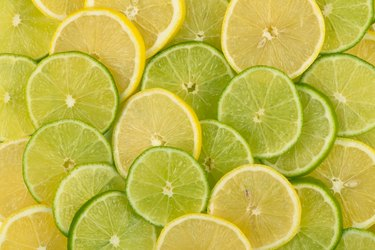 Slices of yellow lemons and green limes
