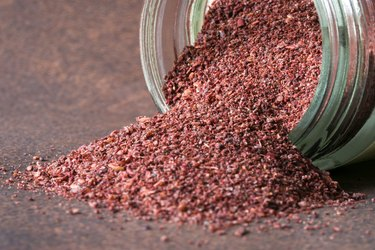 Ground Sumac Spilled From A Spice Jar