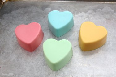 four colorful heart soaps