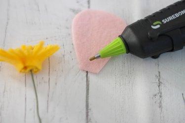 put glue on bottom of petal
