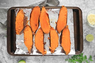 Slice sweet potatoes in half