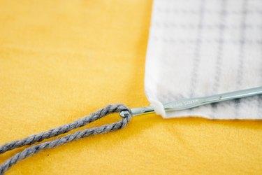 crochet hook lassoing yarn