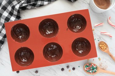 Spread chocolate in remaining molds