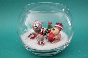 figurines inside smallest fishbowl
