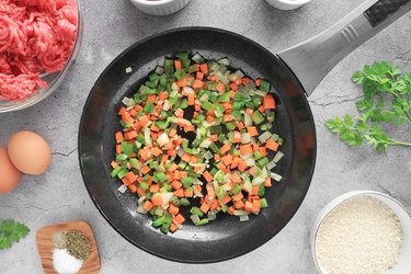 Cook onions, carrots and bell peppers
