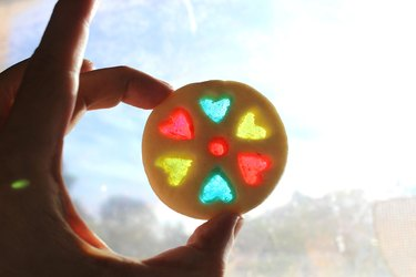 Sparkling stained-glass cookie held up to light