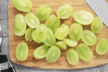 Slice grapes in half