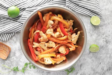 Toss vegetables with oil and spices