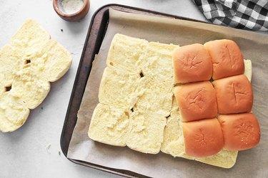 Slice dinner rolls in half
