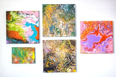 five completed paintings