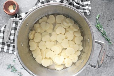 Parboil the potatoes