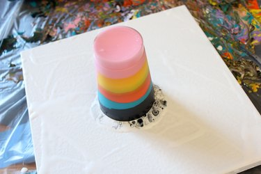 flipped cup on top of canvas
