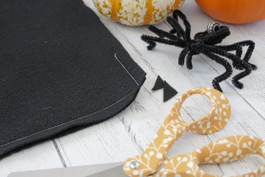This not so itsy-bitsy spider DIY web pillow will create that spooky vibe you're going for.