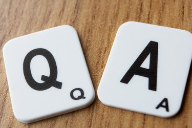 Two scrabble pieces saying Q & A