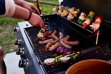 Sausages and shish kebabs on grill
