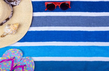 Beach accessories on towel