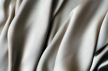 Background with a beautiful wavy silver fabric.