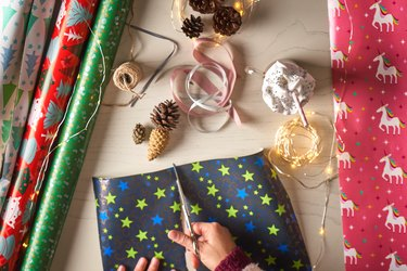 Woman wrapping gifts at home