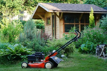 garden cottage lawn mower working in the grass lawn mowing