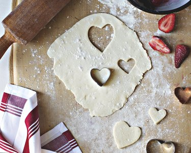 Cutting out dough with heart-shaped cookie cutters
