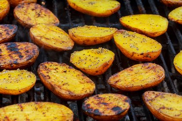 Potatoes on barbecue grill