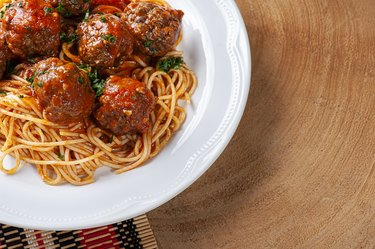Meatballs with tomato sauce and pasta. Top view  - Almondegas.