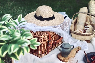 Picnic with bread and tea in summer garden