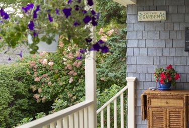 Front Porch of home close up with Hanging Baskets in summer