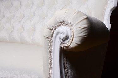 Handle and textile on elegant white sofa