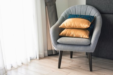 Soft armchair with pillows in the hotel room. The concept of old age and tranquility.