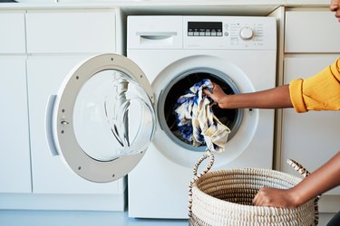 Putting clothes in washing machine