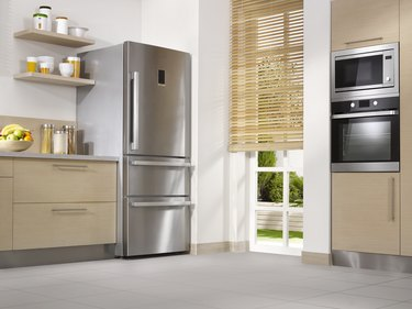 Kitchen with stainless steel refrigerator