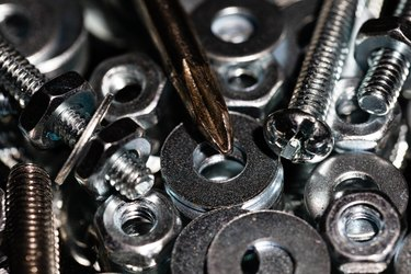 Pile of washers, nuts and screws