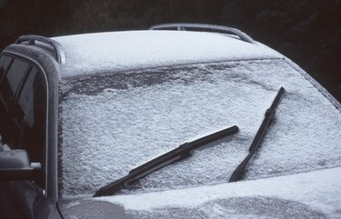 High Angle View Of Snow Covered Car
